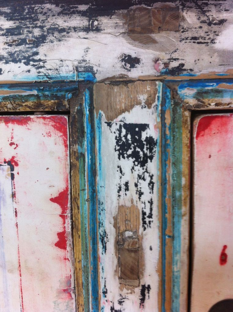 abraded painting of a cupboard